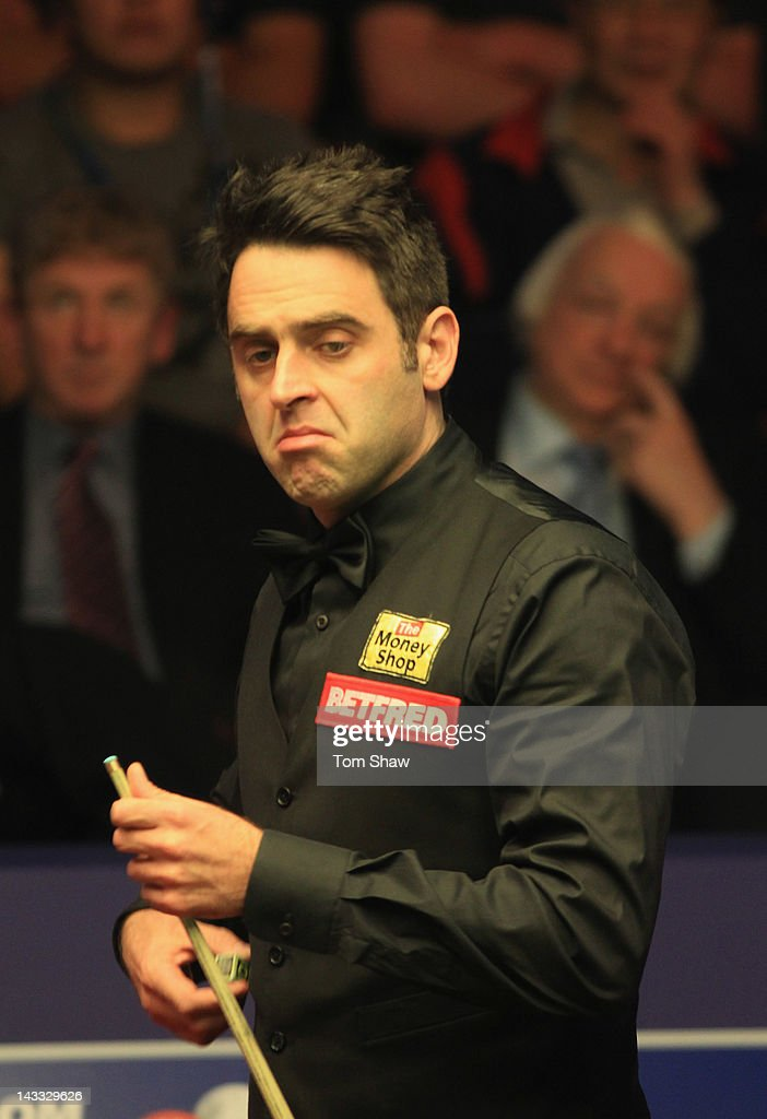 Ronnie O'Sullivan of England looks on in his match against Peter Ebdon of England during the first round of the Betfred.com World Snooker Championship at Crucible Theatre on April 24, 2012 in Sheffield, England.