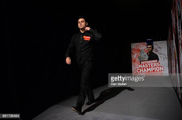 Ronnie O'Sullivan of England makes his way back into the arean following a break during his first round match against Liang Wenbo of China on day one...