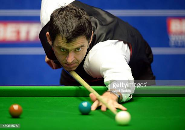Ronnie O'Sullivan of England plays a shot against Craig Steadman of England during day five of the 2015 Betfred World Snooker Championship at...
