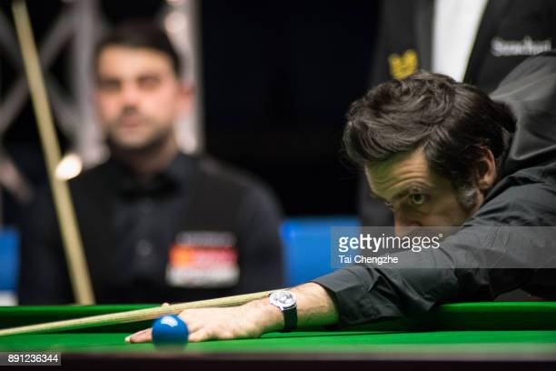 Ronnie O'Sullivan of England plays a shot during his first round match against Michael Georgiou of Cyprus on day two of the 2017 Scottish Open at...