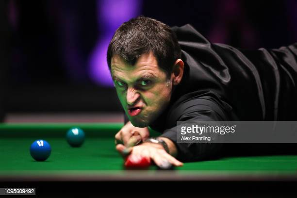 Ronnie O'Sullivan of England plays a shot during his quarterfinal match against Ryan Day of Wales on day five of the 2019 Dafabet Masters at...