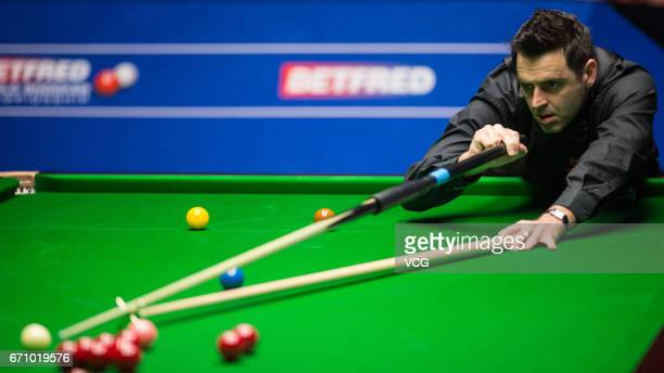 Ronnie O'Sullivan of England plays a shot during his second round match against Shaun Murphy of England on day six of Betfred World Championship 2017...
