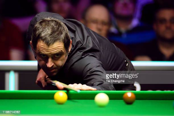 Ronnie O'Sullivan of England plays a shot during the final match against Judd Trump of England on day seven of 2019 Northern Ireland Open at...