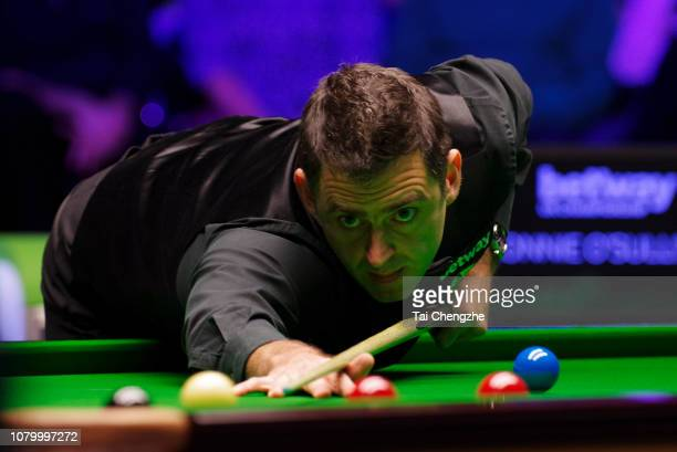 Ronnie O'Sullivan of England plays a shot during the final match against Mark Allen of Northern Ireland on day 13 of 2018 Betway UK Championship at...