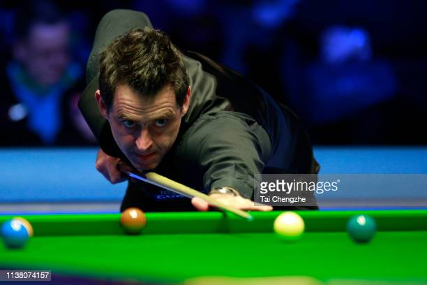 Ronnie O'Sullivan of England plays a shot during the final match against Neil Robertson of Australia on day six of 2019 Coral Tour Championship at...