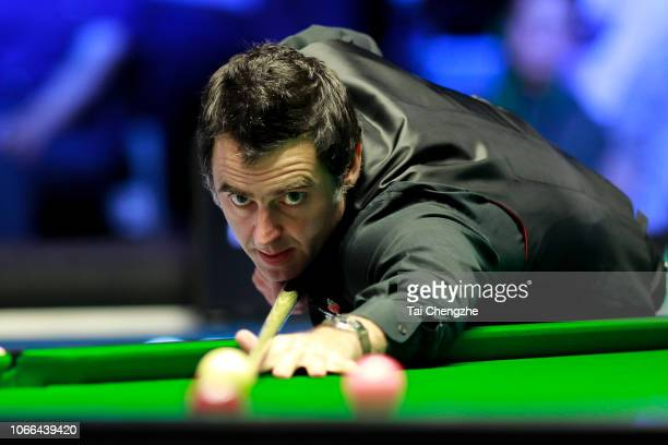 Ronnie O'Sullivan of England plays a shot during the final match against Kyren Wilson of England during the Champion of Champions 2018 at Ricoh Arena...