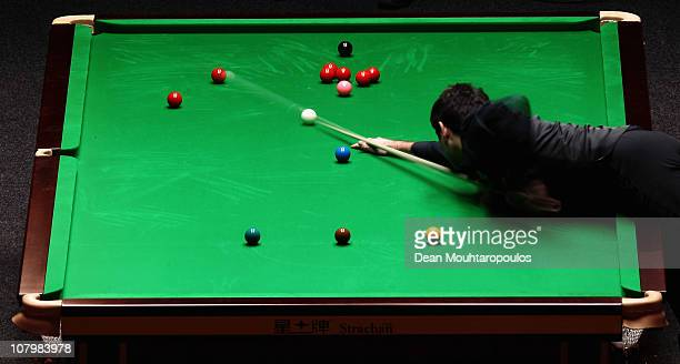 Ronnie O'Sullivan of England plays a shot in his match against Mark Allen of Northern Ireland in Round One of The Ladbrokesmobile Masters on Day 3 at...