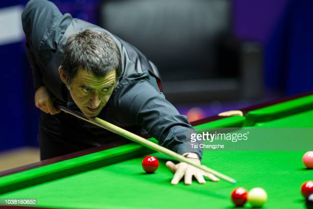 Ronnie O'Sullivan of England plays a shot in the final match against Barry Hawkins of England on day seven of 2018 Shanghai Masters at Regal...