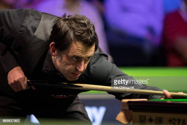 Ronnie O'Sullivan of England plays a shot in the final match against Shaun Murphy of England during the 2017 Betway UK Championship at Barbican...