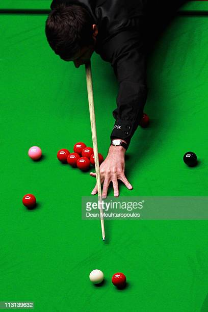 Ronnie O'Sullivan of England plays a shot in the round two game against Shaun Murphy of England on day nine of the Betfred.com World Snooker...