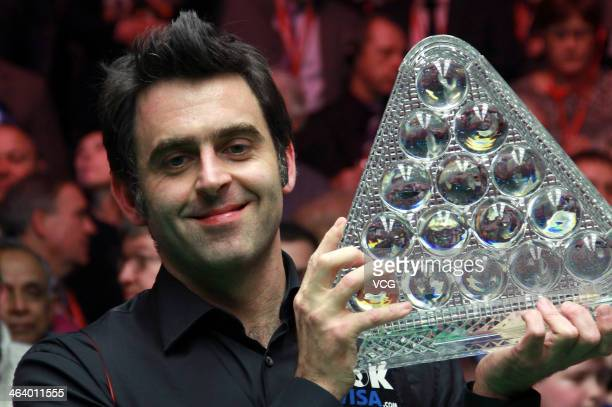 Ronnie O'Sullivan of England poses with his trophy after his match against Mark Selby of England on day eight of the 2014 Dafabet Masters at the...