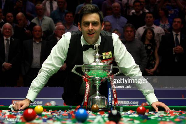 Ronnie O'Sullivan of England poses with the trophy after beating Allister Carter of England in the final of the Betfredcom World Snooker Championship...