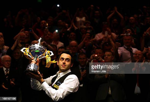 Ronnie O'Sullivan of England poses with the trophy and his son Ronnie after beating Barry Hawkins of England to win the Betfair World Snooker...