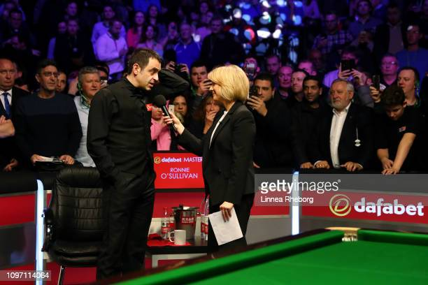 Ronnie O'Sullivan of England reacts as he is interviewed by Hazel Irvine following his defeat in The Dafabet Masters Final to Judd Trump of England...