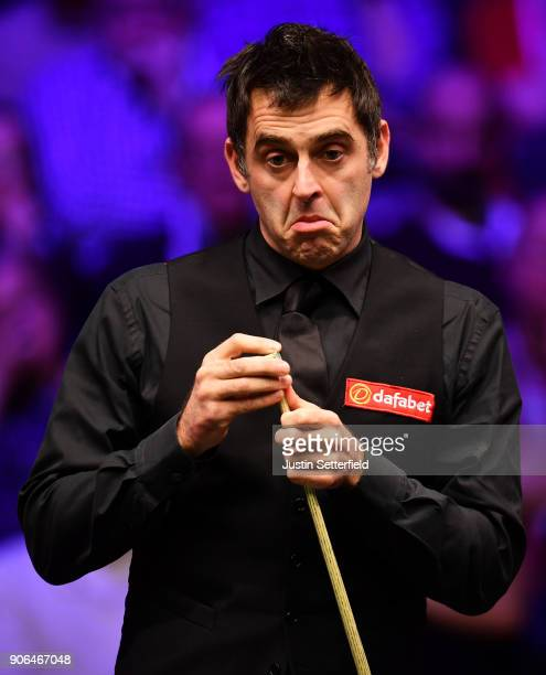 Ronnie O'Sullivan of England reacts during his match against Mark Allen of Northern Ireland during The Dafabet Masters on Day Five at Alexandra...