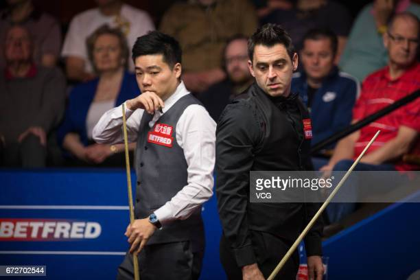 Ronnie O'Sullivan of England reacts during his quarterfinals match against Ding Junhui of China on day eleven of Betfred World Championship 2017 at...