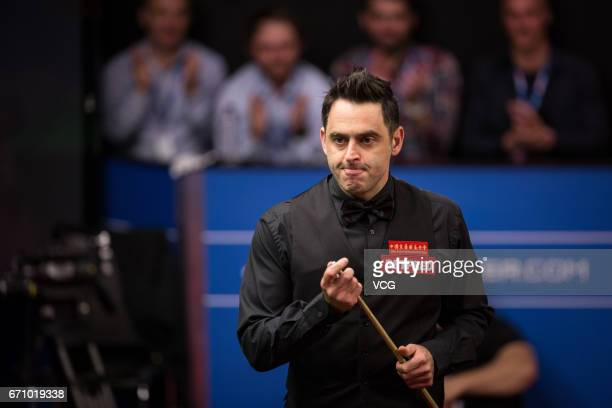 Ronnie O'Sullivan of England reacts during his second round match against Shaun Murphy of England on day six of Betfred World Championship 2017 at...