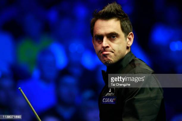 Ronnie O'Sullivan of England reacts during the final match against Neil Robertson of Australia on day six of 2019 Coral Tour Championship at Venue...