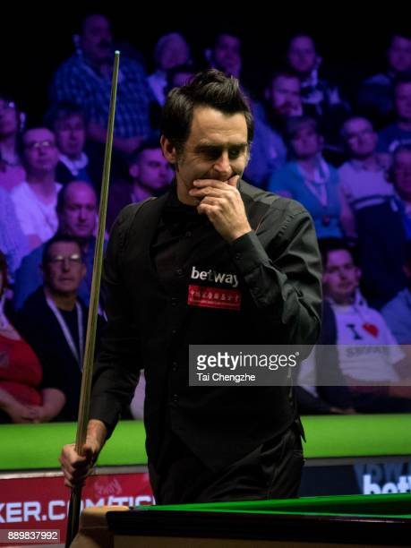 Ronnie O'Sullivan of England reacts in the final match against Shaun Murphy of England during the 2017 Betway UK Championship at Barbican Centre on...