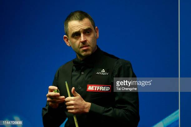 Ronnie O'Sullivan of England reacts in the first round match against James Cahill of England during day four of the 2019 Betfred World Snooker...