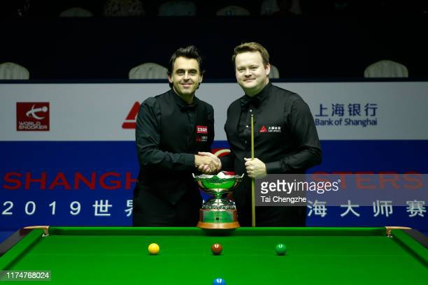 Ronnie O'Sullivan of England shakes hands with Shaun Murphy of England prior to their final match on day 7 of World Snooker Shanghai Masters 2019 at...