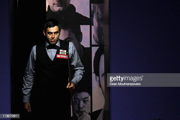 Ronnie O'Sullivan of England walks out to play his round two game against Shaun Murphy of England on day eight of the Betfredcom World Snooker...