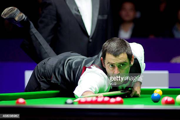 Ronnie O'Sullivan of UK plays a shot against Mark Williams of UK on day five of the World Snooker International Championship 2014 at Sichuan...