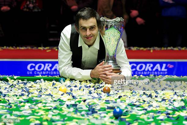 Ronnie O'Sullivan of UK poses with his trophy after defeating Judd Trump of UK on day thirteen of the 2014 Coral UK Championship at York Barbican on...