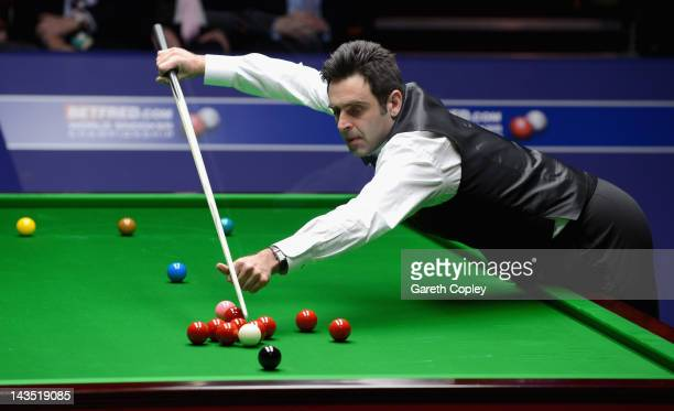 Ronnie O'Sullivan plays a shot in his second round match against Mark Williams during The Betfredcom World Snooker Championship at Crucible Theatre...