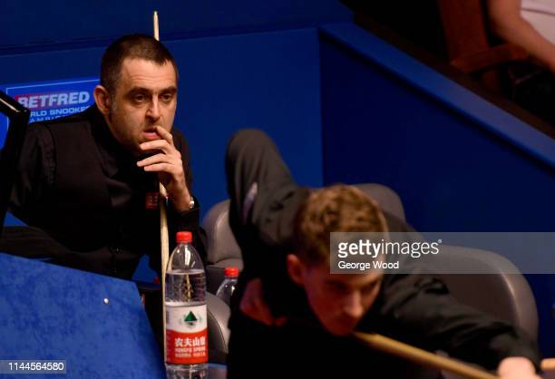 Ronnie O'Sullivan reacts during his defeat against James Cahill in the opening round of the world snooker championship at Crucible Theatre on April...