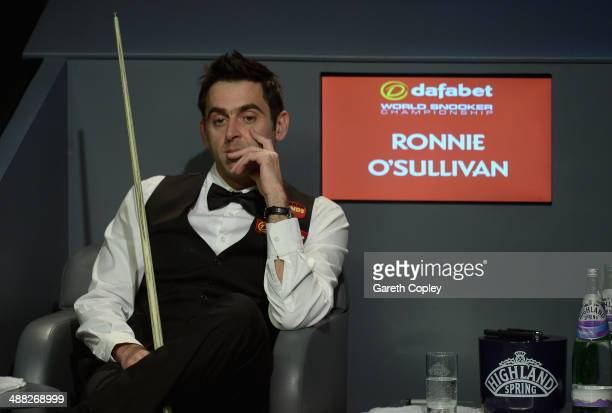 Ronnie O'Sullivan sits in his chair during The Dafabet World Snooker Championship final against Mark Selby at Crucible Theatre on May 5 2014 in...