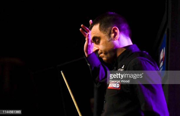 Ronnie O'Sullivan waves as he walks out prior to his defeat against James Cahill in the opening round of the world snooker championship at Crucible...