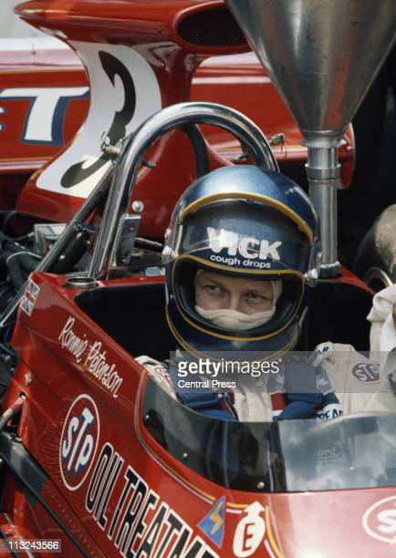 Ronnie Peterson sits aboard the STP March Racing Team March 721G Ford Cos DFV 30 V8 before the start of the British Grand Prix on 15th July 1972 at...