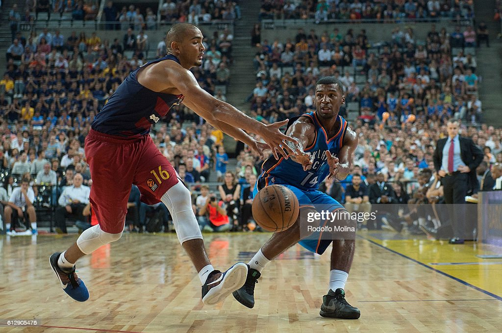 Ronnie Price, #14 of Oklahoma City Thunder competes with Stefan Peno, #16 of FC Barcelona Lassa during the NBA Global Games Spain 2016 FC Barcelona Lassa v Oklahoma City Thunder at Palau Sant Jordi on October 5, 2016 in Barcelona, Spain.