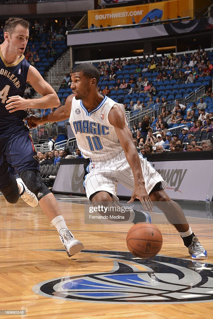 Ronnie Price #10 of the Orlando Magic dribbles to the basket against the New Orleans Pelicans the game on October 25, 2013 at Amway Center in Orlando, Florida.