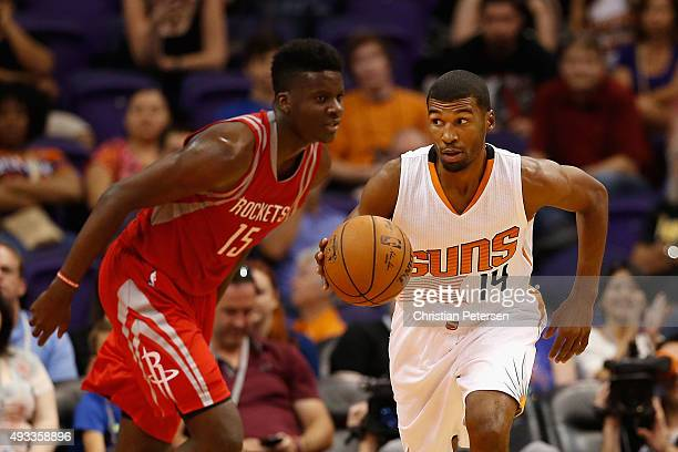 Ronnie Price of the Phoenix Suns moves the ball past Clint Capela of the Houston Rockets during the preseason NBA game at Talking Stick Resort Arena...
