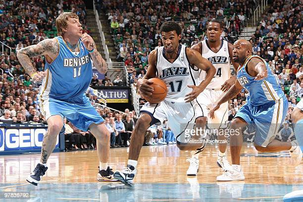 Ronnie Price of the Utah Jazz drives down the lane against Chris Andersen and Anthony Carter of the Denver Nuggets during the game at EnergySolutions...