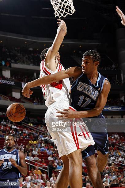 Ronnie Price of the Utah Jazz passes against Jared Jeffries of the Houston Rockets during the game at Toyota Center on April 7 2010 in Houston Texas...