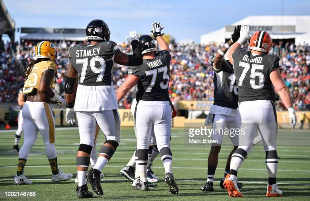 Ronnie Stanley Marshal Yanda of the Baltimore Ravens and Joel Bitonio of the Cleveland Browns celebrate the touchdwown in the first half of the 2020...