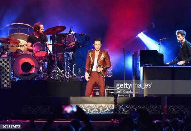 Ronnie Vannucci Jr and Brandon Flowers of The Killers perform on What Stage during day 4 of the 2018 Bonnaroo Arts And Music Festival on June 10 2018...