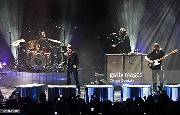 Ronnie Vannucci Jr Brandon Flowers Dave Keuning and Mark Stourmer of The Killers perform on stage during iTunes Festival at The Roundhouse on...