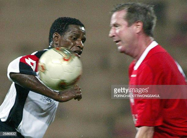 Ronnie Whelan of former Liverpool player battles for the ball with Andrade former Flamengo player during friendly match in Bangkok 13 October 2003...