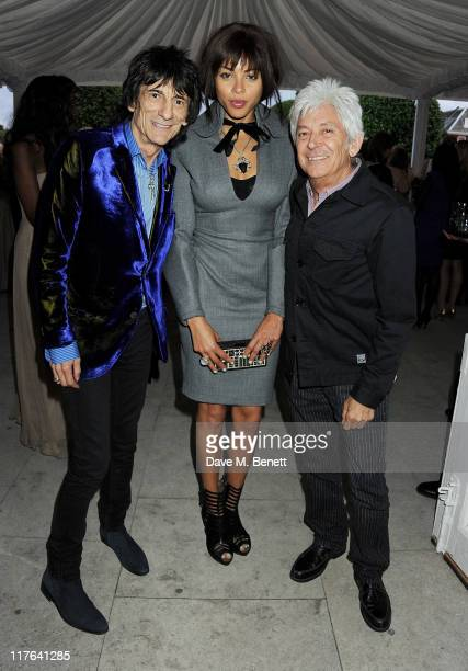 Ronnie Wood Ana Araujo and Ian McLagan attend the English National Ballet Summer Party held at The Orangery at Kensington Palace on June 29 2011 in...