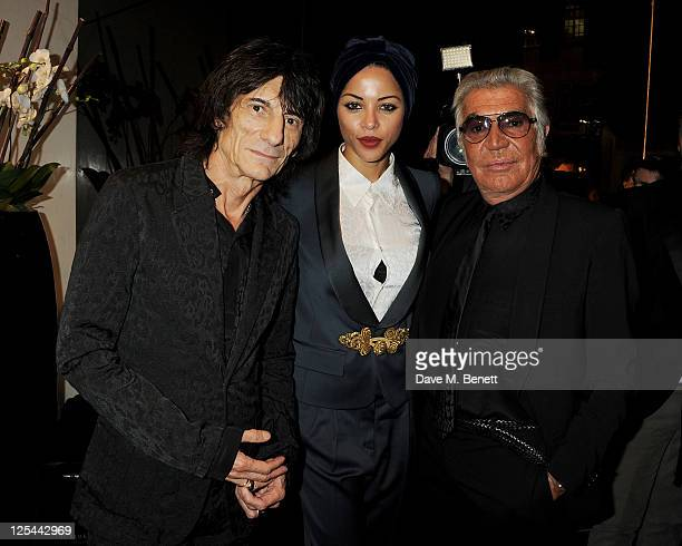 Ronnie Wood Ana Araujo and Roberto Cavalli attend the opening of Roberto Cavalli's new Sloane Street boutique on September 17 2011 in London England