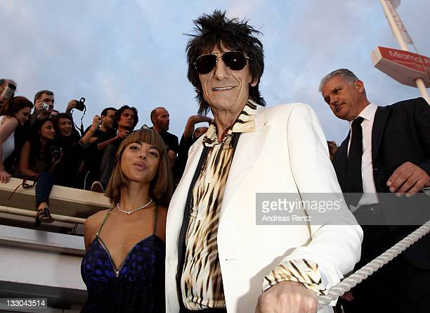 Ronnie Wood and Ana Araujo attend the Cavalli Boutique Opening during the 64th Annual Cannes Film Festival on May 18 2011 in Cannes France