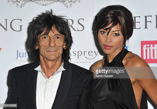 Ronnie Wood and Ana Araujo attend the FitFlop Shooting Stars Benefit Closing Ball following a twoday golf tournament raising vital funds for...