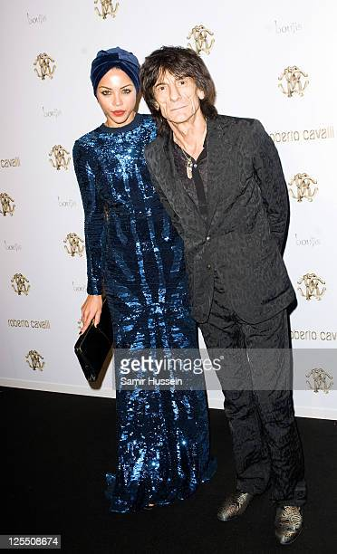 Ronnie Wood and Ana Araujo attend the Roberto Cavalli Store Launch After Party at Battersea Power Station on September 17 2011 in London England