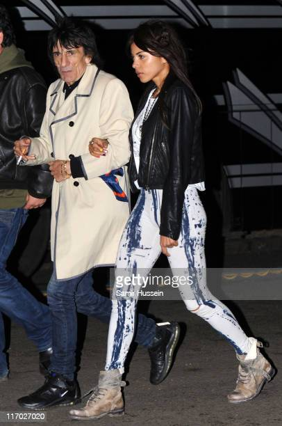 Ronnie Wood and Ana Araujo walk backstage during the Feis Festival in Finsbury Park on June 18 2011 in London England