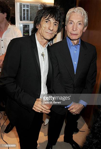Ronnie Wood and Charlie Watts attend the launch of jockey Frankie Dettori's new restaurant 'Cavallino' on June 13 2011 in London England