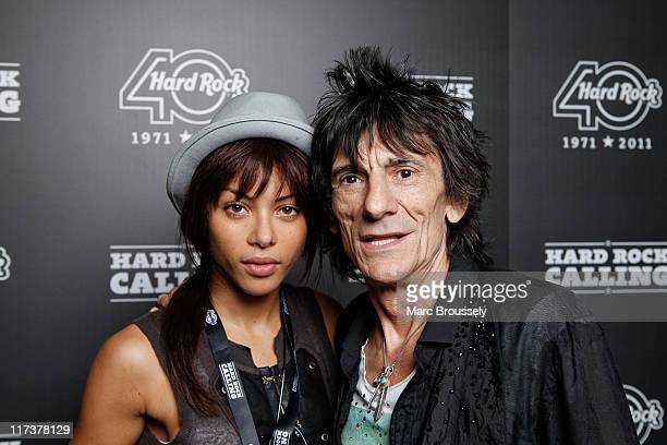 Ronnie Wood and girlfriend Ana Araujo pose for portraits as they attend the Hard Rock Cafe VIP Tent during the third and final day of Hard Rock...